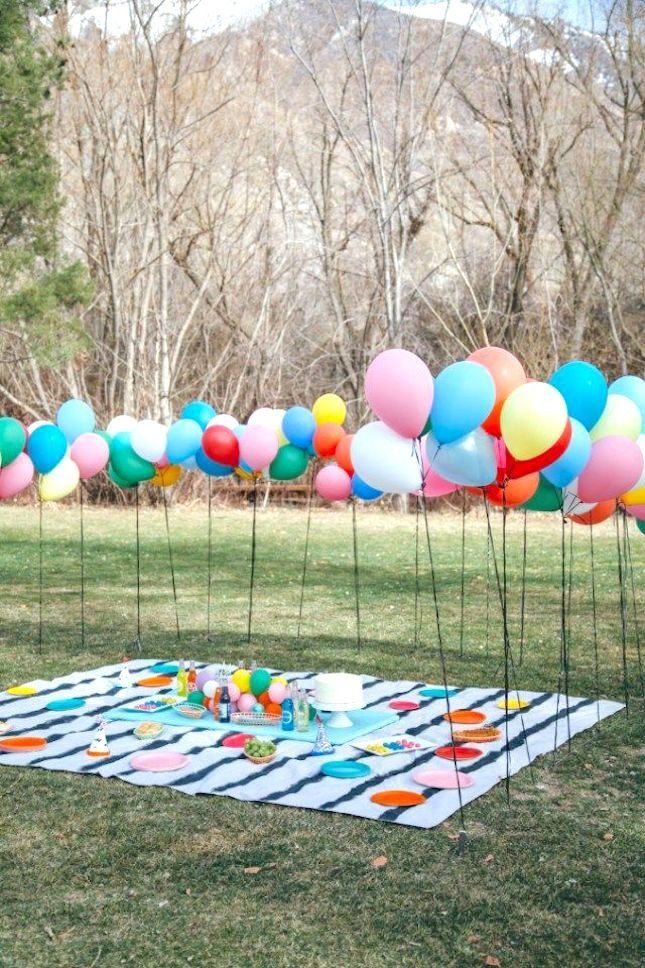 Throw a birthday party in the park with colorful balloons!