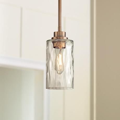 This satin brass finish mini pendant features a cylinder of elegant hand blown hammered glass 11 high x wide x canopy is 5 wide x hang weight is lbs - brass and glass pendant light