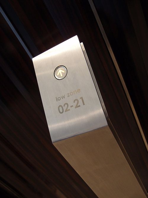 Elevator buttons at ground level.