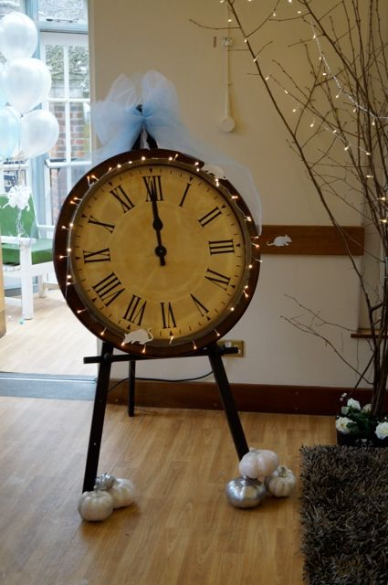 Cinderella party clock. Near the table cards and guest book