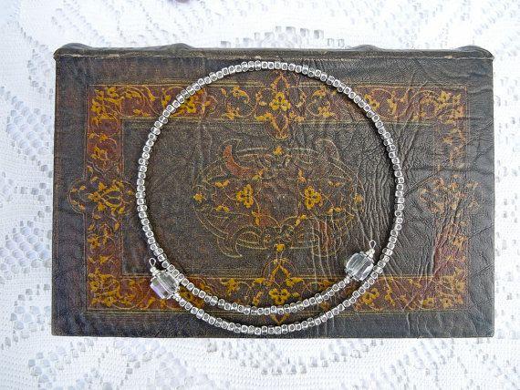Collana di metallo artigianale con vetro trasparente agli estremi