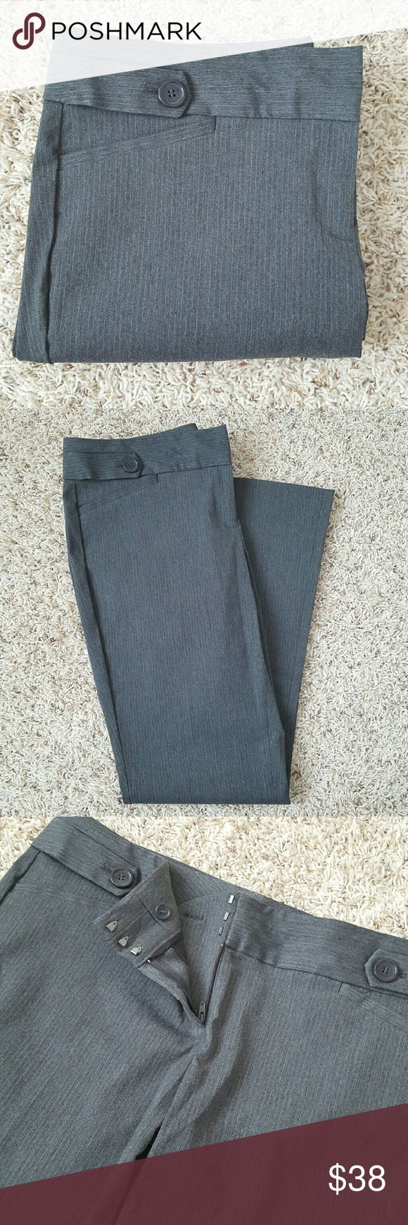 Exact Stretch Classic Flare Pants These pants have amazing stretch throughout except for waistline and are really comfy. Pants feature 3 hook and tab waist with inner button and zip fly, faux front pockets, and buttoned welt back pockets. Pre-loved and in great condition. 56% polyester, 21% viscose, 20% nylon, 3% spandex. Machine washable.  Color is dark grey with subtle pinstripe detail. Size is 14R. The Limited Pants Boot Cut & Flare