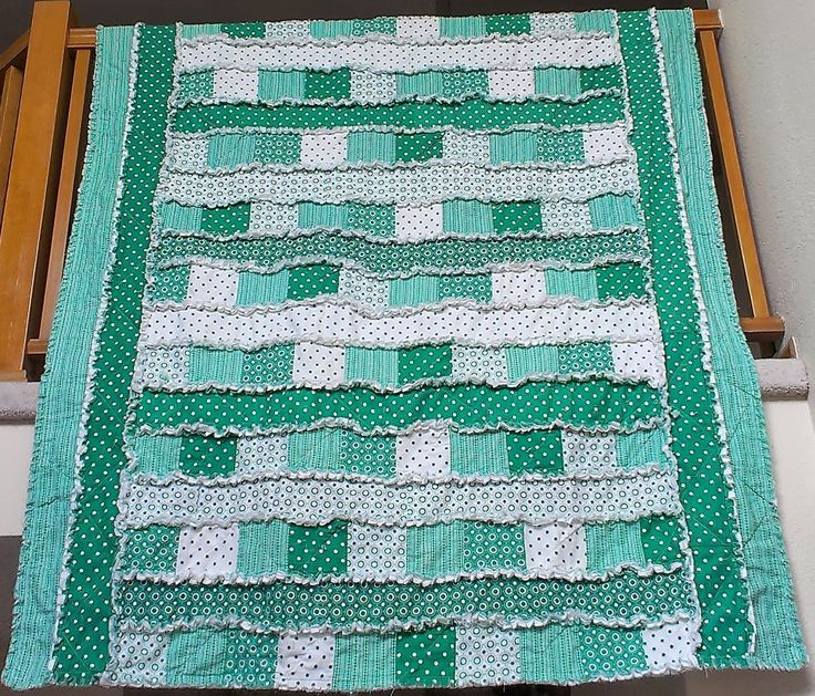 """Patchwork & Strip #ragquilt - 60"""" x 120"""" - 100 #charmsquares and 7 #fatquarters for front, 4 yards flannel for batting, 4 yards backing fabric. 1/2 inch rag seams; 8 strips hidden over edge"""