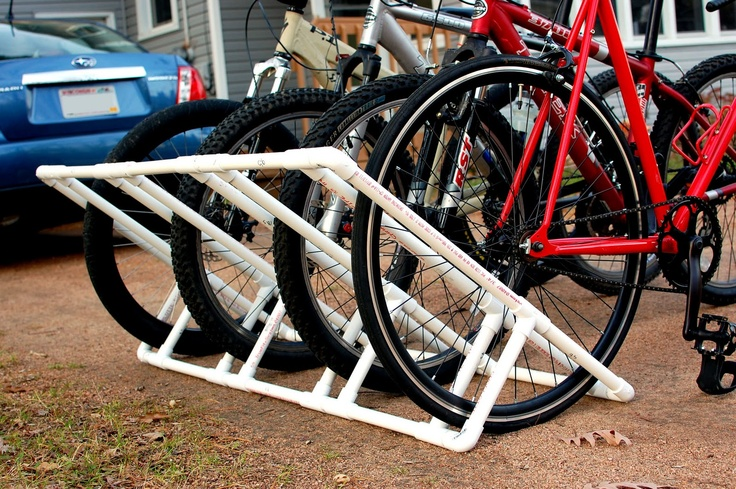 I need one of these for all the kid bikes and scooters that clutter up my garage. Made from PVC = looks pretty easy