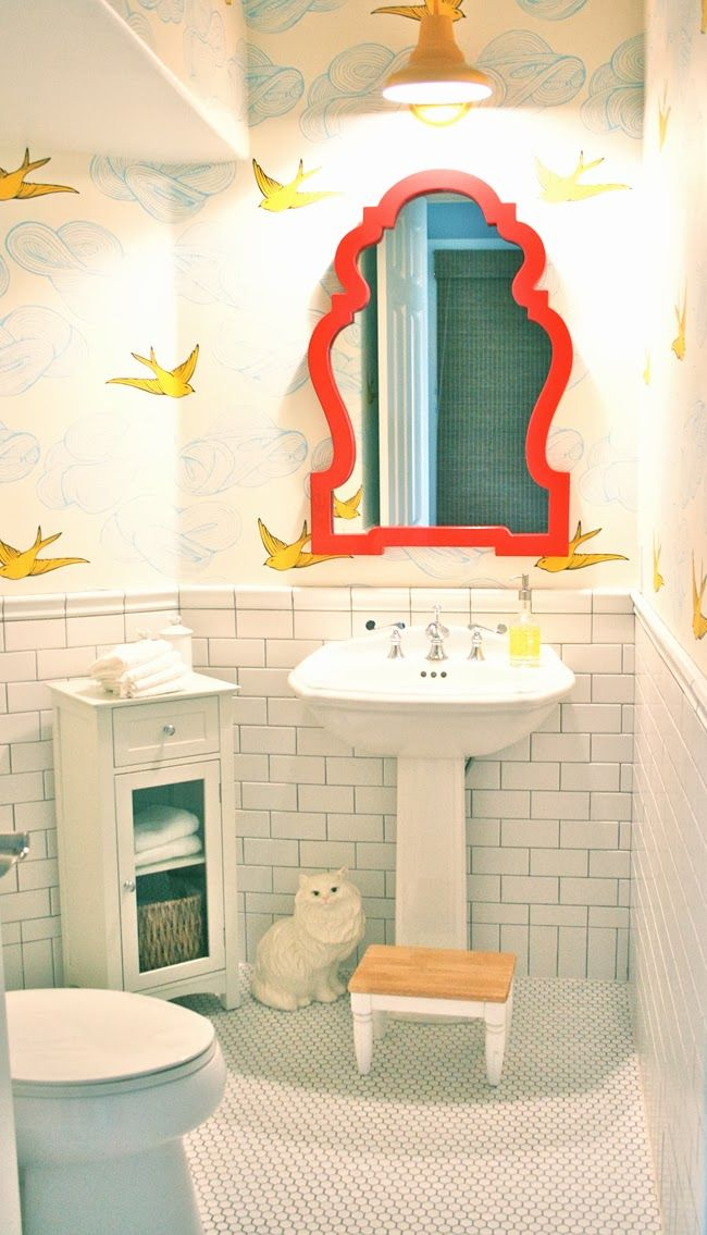 ok so i admit this picture is from a photo spread of some Romney's house and overall the aesthetic is too 1%-does-faux-shabby-chic sterile for me, BUT I always like to see wallpaper that would work in our terrible yellow-tiled bathroom, plus that ceramic cat is the jam, so. good job on this bathroom, Romneys.