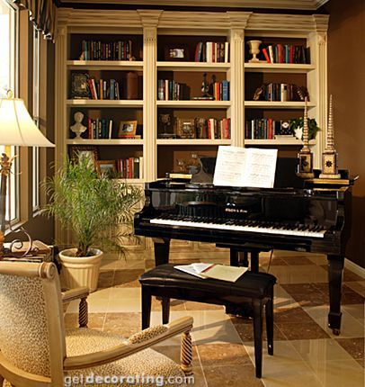 I like the book cases in the back.  Standard bookcases with crown molding and trim to finish and make it look built in.
