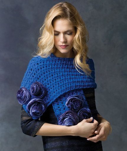 Rose Parade Wrap Free Crochet Pattern in REd Heart Yarns -- Crochet this soft wrap then embellish it with a spray of roses. It's the perfect scarf accessory that is wide enough to double as a shawl.