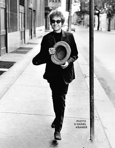 Bob Dylan Walking With Top Hat in Philadelphia PA 1964, Daniel Kramer Dylan on the way to the now-notorious Philadephia concert. A bootleg of this concert has been available under the title The Chimes of Philadelphia: the set opened with The Times they are a Changing and ended with The Lonesome Death of Hattie Carroll and All I Really Want To Do. This was the first time Kramer saw Dylan live