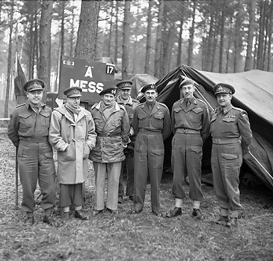 Montgomery visiting Canadian troops in the Kleve-Goch sector, Germany, 26 Feb 1945; left to right: Vokes, Crerar, Montgomery, Horrocks, Simonds, Spry, Mathews.