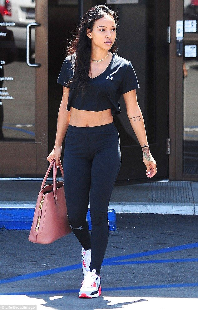 Karrueche Tran Flashes Her Taut Tummy In Form Fitting