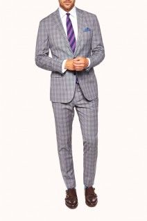 Cut with today's gentleman in mind, the Marquette Suit's traditional Prince of Wales check is a timeless reprieve from navy and black suiting. Available at M.J.Bale.