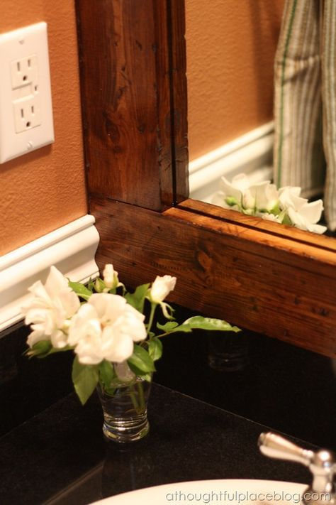 A Thoughtful Place: How to Frame a Bathroom Mirror {Distressed Wood}