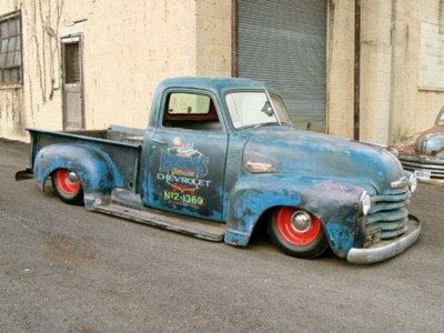 dropped 48-52 Chevy truck. Cool signage and patina.