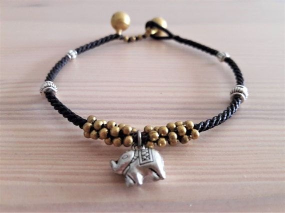 Welcome to Bohemian Style Thai Elephant Collection!  Youre looking at a striking and elegant black macrame woven band, with a silver-plate elephant charm, genuine antique silver pieces, and brass bead cluster.   www.bohemianstyleshop.etsy.com
