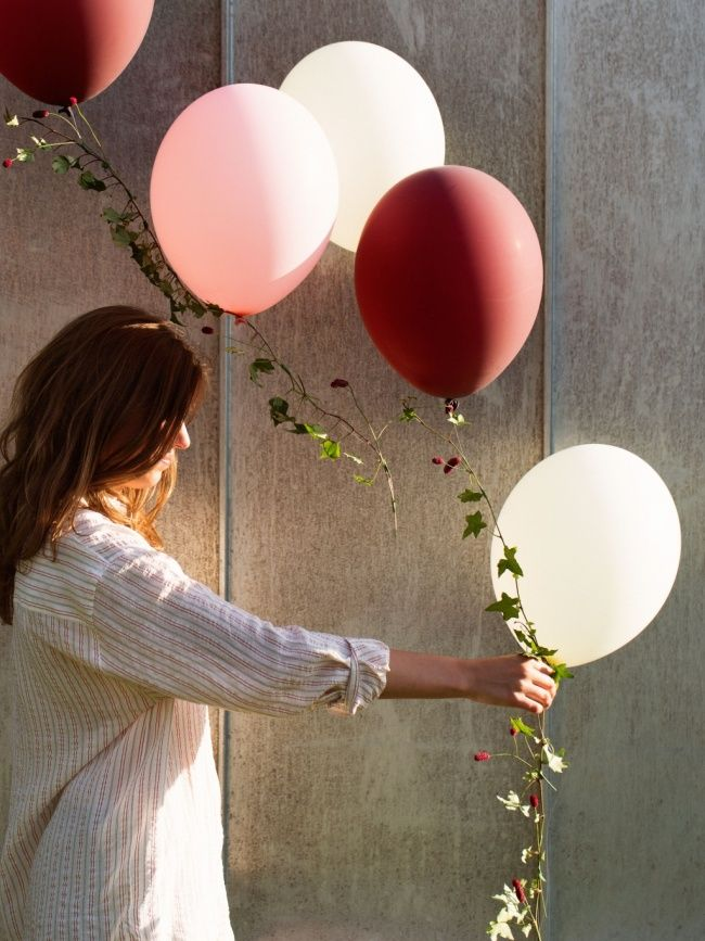 Beautiful! Balloons on a plant string (hedera for instance)