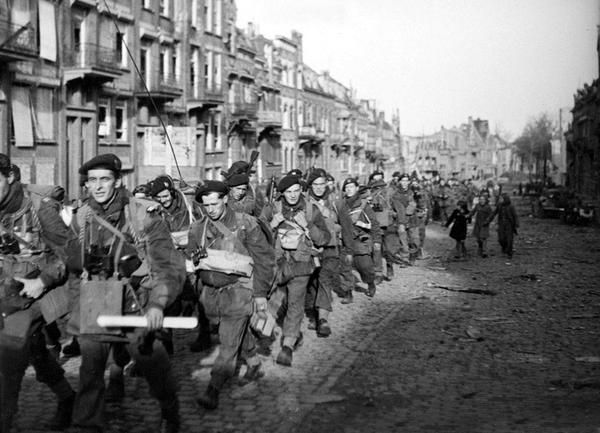 British Commandos march through the city of Vlissingen during the capture of island Walcheren, Holland, 1944.