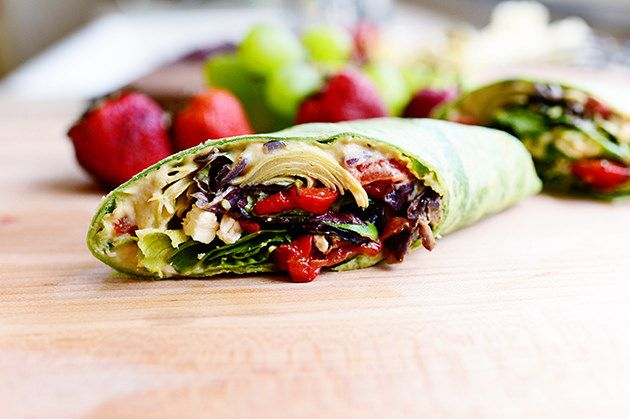 Heavenly Hummus Wrap - Grilled onions and pepper plus artichoke hearts, hummus and feta with greens tossed in salad dressing all wrapped up. This is going on the menu for next week.