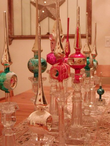 antique tree toppers in crystal candle holders - nice blog - http://americanharvest.typepad.com