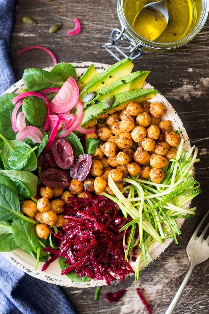 Vegan buddha bowl with beetroot, spinach, cumin-roasted chickpeas, olives, avocado & pickled onions is a quick lunch heaven. Filling and contains no gluten.