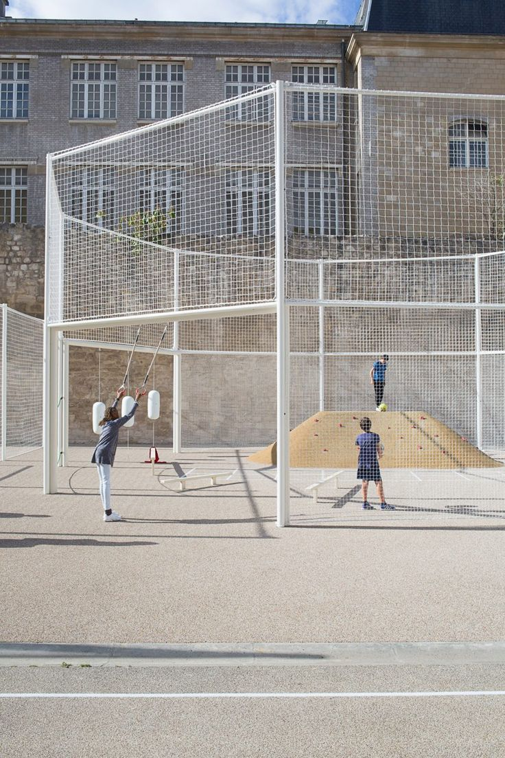 French studio NP2F Architectes has squeezed a football field, tennis court and running track onto a long strip of land in Paris's Saint-Paul area