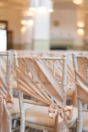 Satin Ribbon Sashes on Ceremony Chairs | photography by http://www.bluerosepictures.com