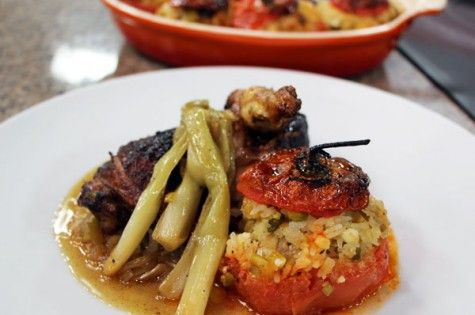 Roasted spiced chicken with stuffed tomatoes and five lilies sauce