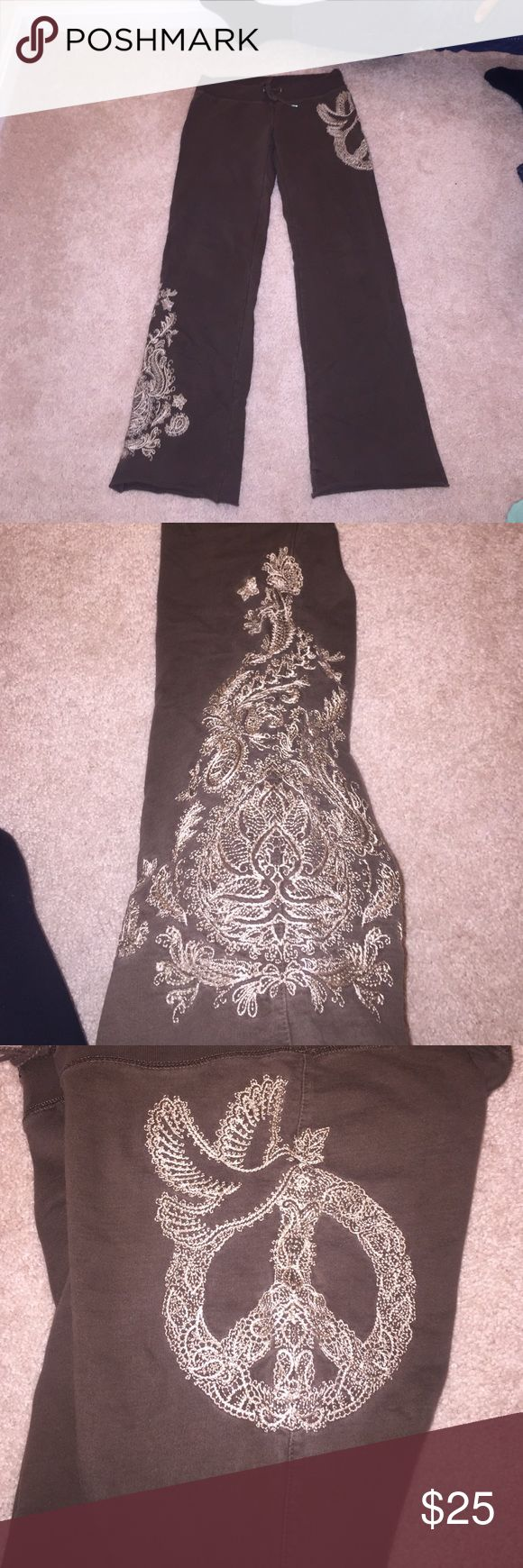 Lucky Brand lounge pants EUC Lucky Brand sweat/lounge pants with embroidered designs. Inseam 30 inches. Drawstring waist. Size XS but would fit a S or M better. Very comfortable. There is tiny snag at the very bottom of pants but you can't even tell when they are on and can be easily sewn. (price reflects) Bought for $70+tax. If you have any questions, please ask!! EVERYTHING MUST GO!! ALL PRICES ARE VERY LOW!! I SHIP SAME OR NEXT DAY! Lucky Brand Pants