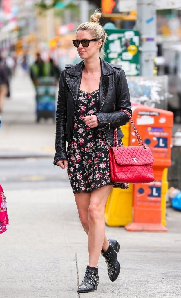 Nikki Hilton toughened up her petal-print mini dressed with a leather moto jacket