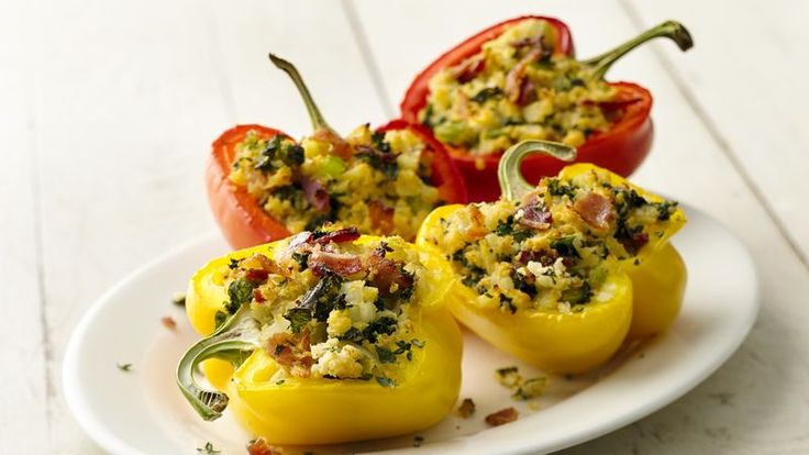 Cauliflower, bacon and kale combine to create a Paleo-friendly version of stuffed peppers. We promise you won't miss the rice.