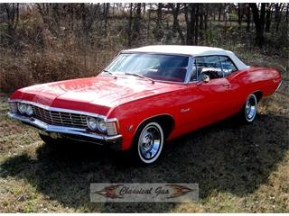 Top up or down, this '67 Impala is red hot! I'll take it.