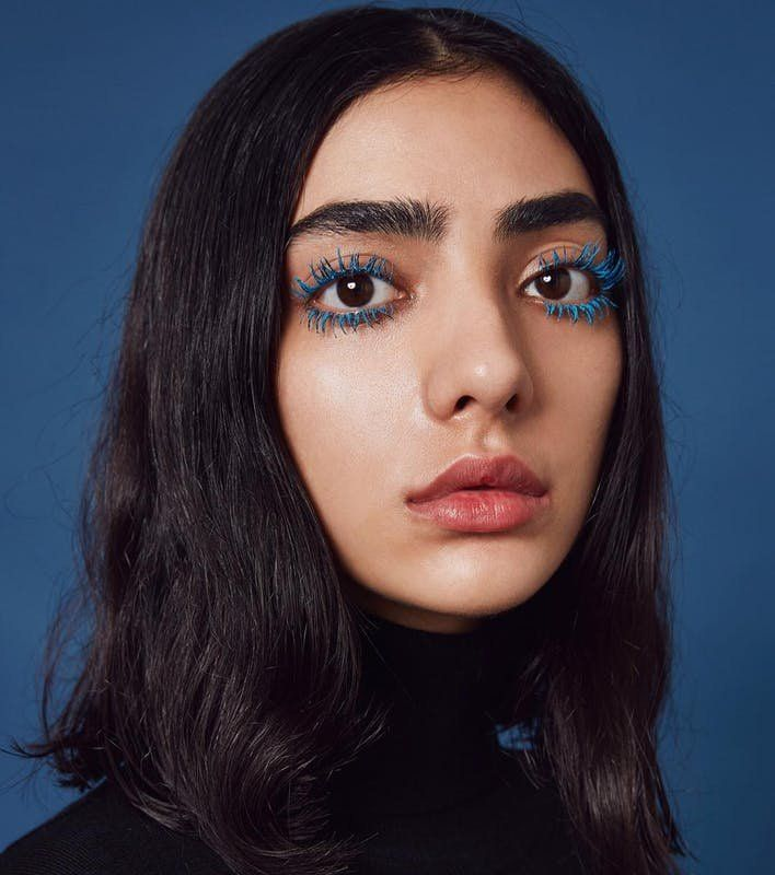Achieve a moody look with spidery blue lashes perfect for winter.