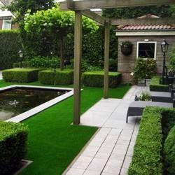 Kunstgras voordelen - Kunstgras in de tuin aanleggen - Tuinaanleg