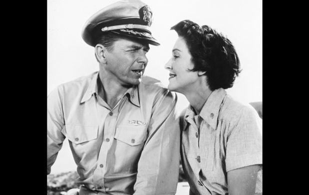 The Reagans look into each other's eyes while starring in their first and only film together, Hellcats of the Navy, in 1957. Ronald and Nancy respectively played World War II Commander Casey Abbott and Nurse Lieutenant Helen Blair in the movie. (Photo by Silver Screen Collection/Getty Images)