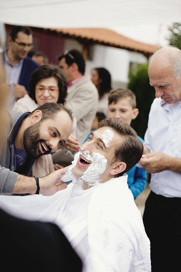 Friends shaving the groom before the ceremony! Greek traditional Wedding in Greece #groom #ceremony #wedding #day #shave #no #beard
