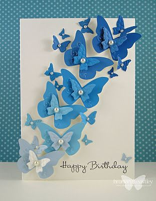 beautiful handmade card ... swarm of punched butterflies in blue ... like the dimension ... lovely ombre effect moving from light blue upwards to dark blue ...