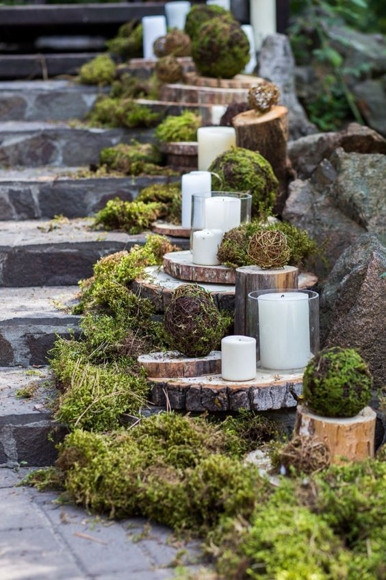 rustic moss and tree stump wedding decor