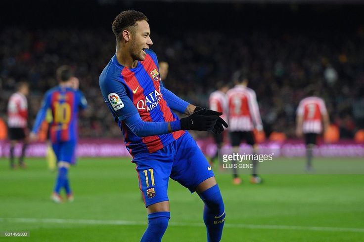 Barcelona's Brazilian forward Neymar celebrates after scoring a goal during the Spanish Copa del Rey (King's Cup) round of 16 second leg football match FC Barcelona vs Athletic Club de Bilbao at the Camp Nou stadium in Barcelona on January 11, 2017. / AFP / LLUIS