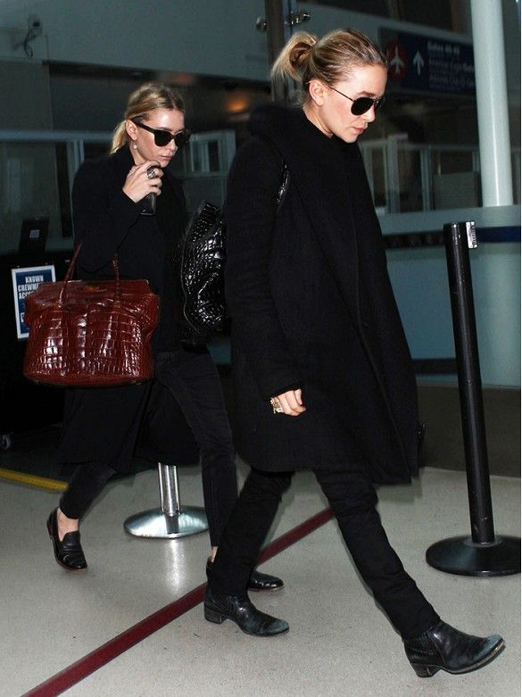 Mary-Kate and Ashley Olsen in their all-black uniform for holiday travels