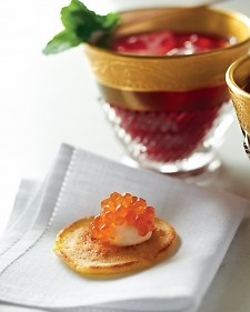 These traditional Russian pancakes are best with authentic garnishes: a dab of creme fraiche and a spoonful of caviar. (Martha Stewart - Christmas Brunch ideas).