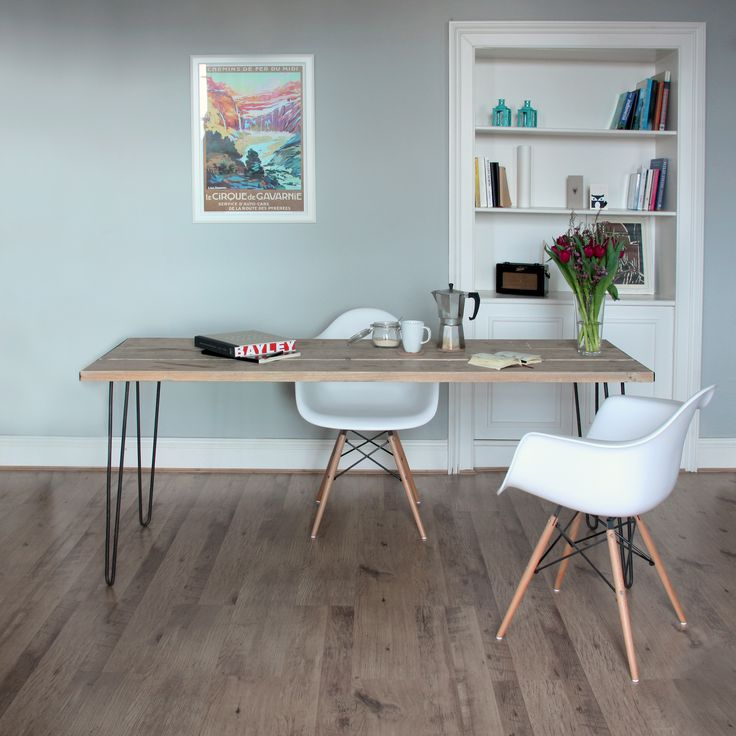 Upcycled scaffold plank table top with mild steel hairpin legs, Eames chairs and coffee.