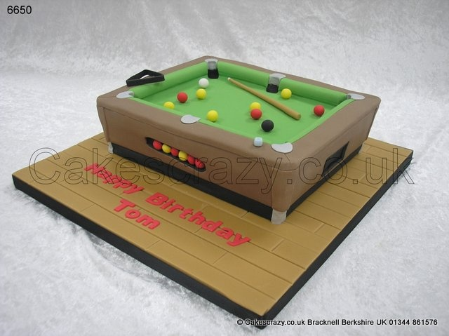 Pool Table Cake. The pool hustlers cake... Novelty shaped celebration cake in the shape of a pool table complete with balls, cue and triangle
