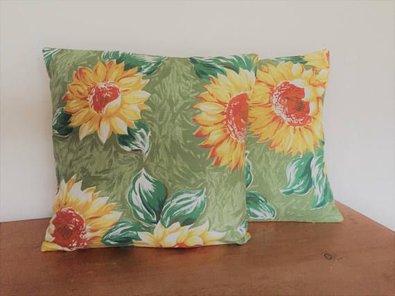 This lovely Retro Sunflower fabric has been given a new lease of life with a sunny yellow back and flower button finish.  I have 2 of these each with slightly different pattern placement - as shown in the pictures above  They measure 14 by 14 (36cms by 36cms)  The have an envelope style closure on the back.  They can be purchased with or without the polyester cushion pad either singly or as a pair  The covers are lined and have finished seems for extra durability.  The can be occasionally…