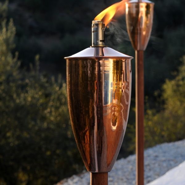 Athena Oillamp gardentorch, olielampe  This popular classic torch design is made in Shiny cobber, shiny steel, and brushed steel