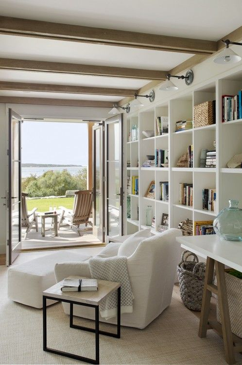 """library"" type shelves with lights above.  Beach Barn - Hutker Architects"