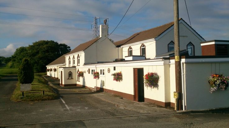 Cardinals Hatt - if you don't want to stray too far, it is right at the Hatt roundabout and you'll find it on the left.  Selection of Cornish beers and freshly prepared food (good fish & chips!).  Fully wheelchair accessible & accessible WCs.