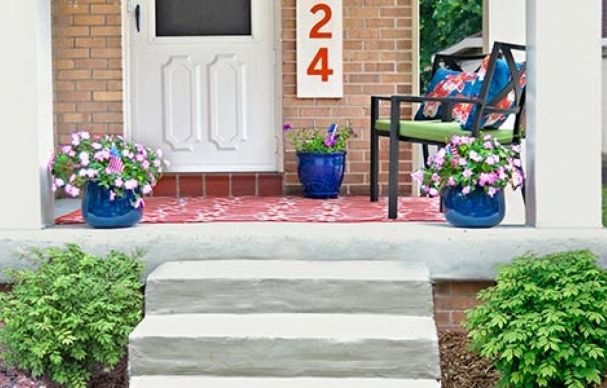 Craftsman-style pillars give a tired front entry a welcoming face