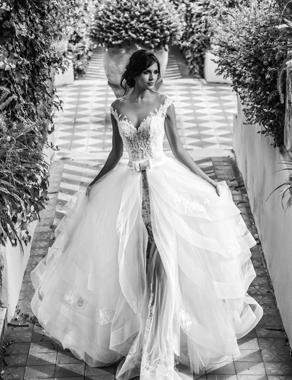 Alessandro Angelozzi Couture The trend of wearing more than one dress for the wedding day calls a bigger desire to be stylish, fun, and different. However, not every bride has the budget for multiple dresses, or the time to get changed on the big day.