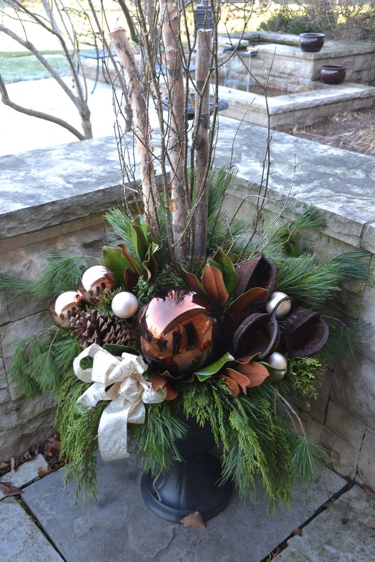 Big Brown Ball in Christmas Urn oK I just wish the sticks weren't so high...