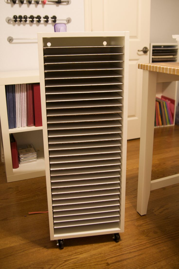 """My new paper storage. I bought an Ikea upper cabinet (size 15x39"""") base (item 443.832.10) for a shell for my storage solution. Then, I went to the hardware store and bought two 1/8""""x4'x8' panels. I purchased the cheapest white panelling they had, though they sell slightly more expensive and slightly thicker bead board in the same section. I had them cut each piece to 11 1/2""""x13 3/8"""". I was able to get 28 shelves out of one panel, which is exactly what was needed for this cabinet (I bought 2"""