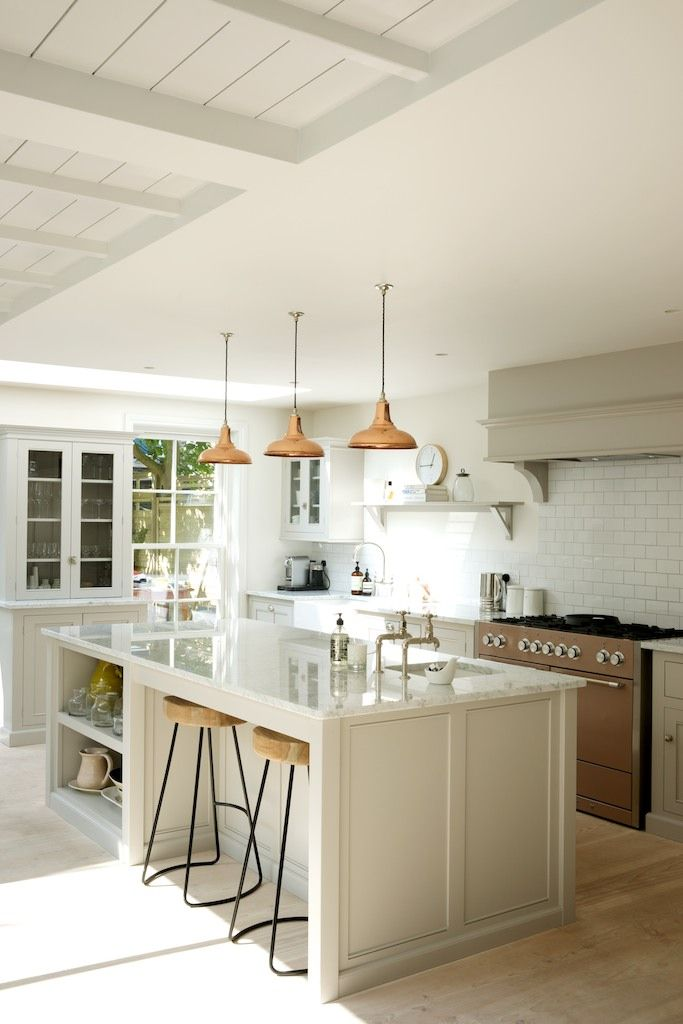 The large island creates a perfect family kitchen in deVOL's Classic Clapham Kitchen.